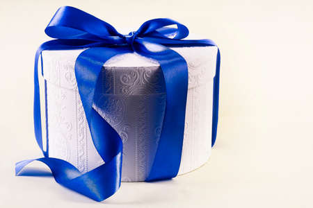 White box with a blue bow, isolated on a white background