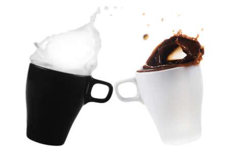 White mug with coffee and black mug with milk isolated on white background - splash