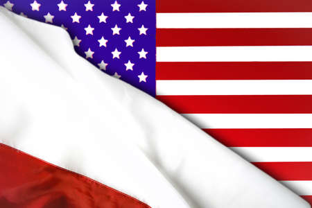 United States and Poland. Polish flag on the background of the American flag Фото со стока