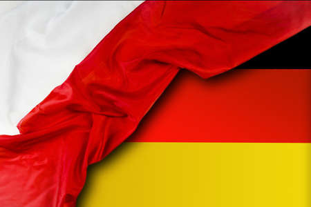 Germany and Poland. Polish flag on the background of the German flag