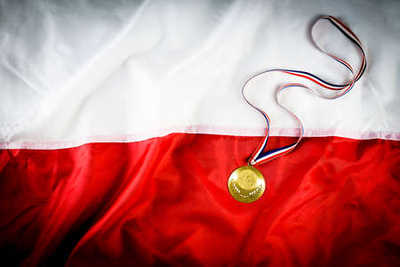 Gold medal on a white-red flag background