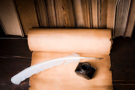 Scroll of parchment, and a pen and inkwell 版權商用圖片