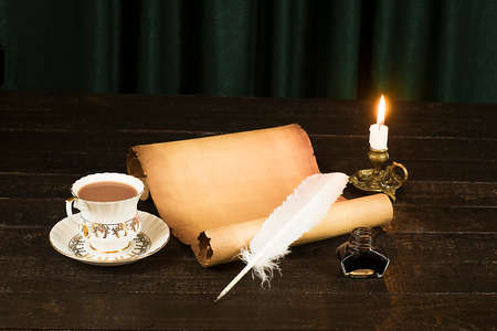 A cup of drink, a scroll of papyrus, a feather, and a lit candle