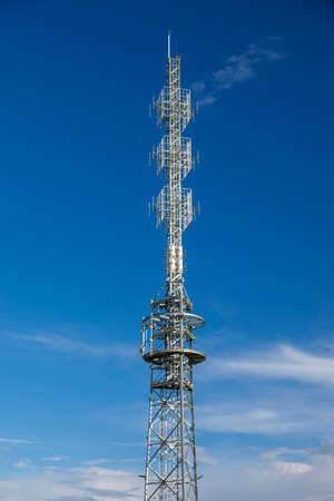 Radio tower on a background of blue sky.