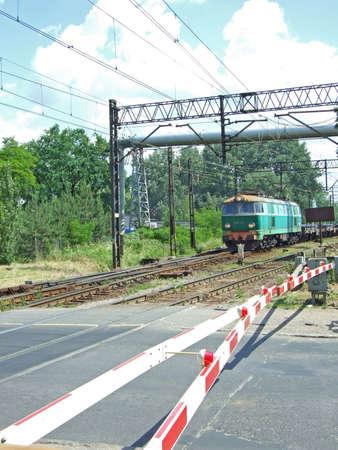 rail crossing with train  photo