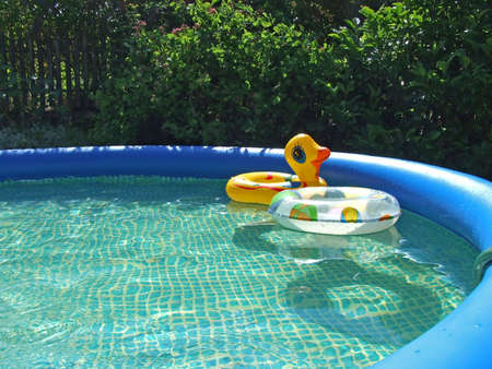 waterpool with toys in the garden
