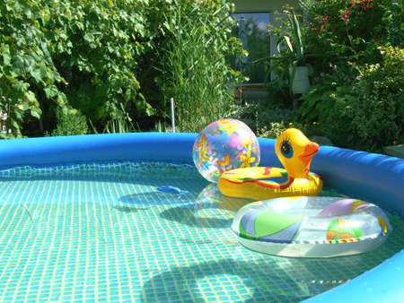 pool game: waterpool with toys in the garden