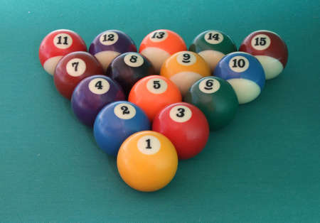 poolball: 15 billiard balls on the green billiard table