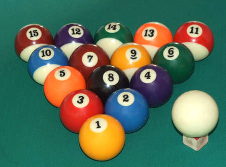 poolball: fifteen billiard balls in the black triangle with white ball