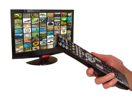 women's hand: Digital television and remote control in womens hand, on white