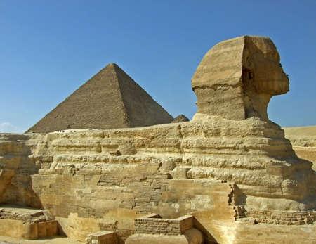 Sphinx and pyramid on an Egipt desert