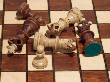 pawn king: Closeup on pawn, king and queen beaten