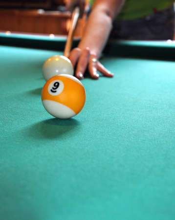 poolball: Womens hand holding billiard stick ready to shot