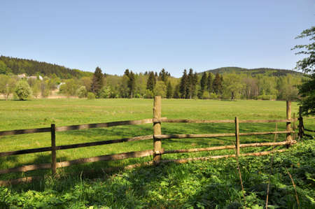 Wooden fence in front of mountains landscape