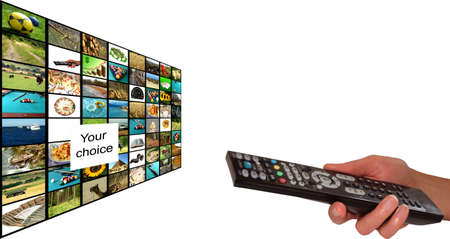 Remote in womens hand chosing channel Stock Photo - 5104709