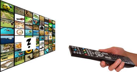 Remote in womens hand chosing channel Foto de archivo