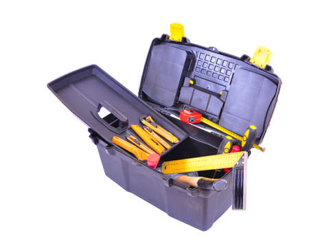 Open toolbox with many different tools, isolated on white with clipping path photo
