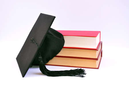 Student hat on books