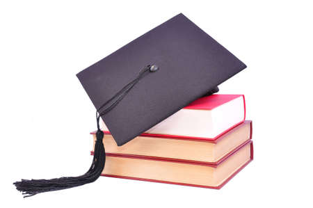 Student hat on books, on white Stock Photo