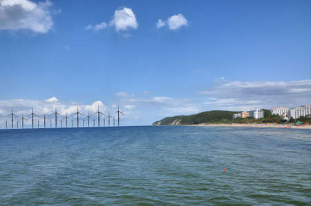 A lot of windmill at the sea coast photo