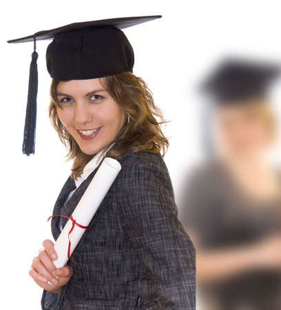 Young woman with graduation diploma and graduation hat, second graduate studend blurry in background
