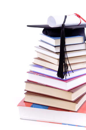Student hat on a tower made of books, against a white background - Education concept Stock Photo