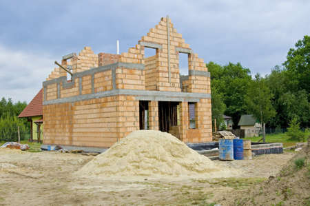 Unfinished, one family house made of brick photo