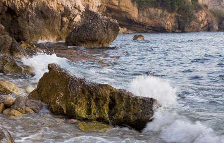 Sea waves splashing the rock Stock Photo - 7755346