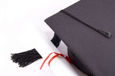 alumna: Student hat and diploma isolated on white