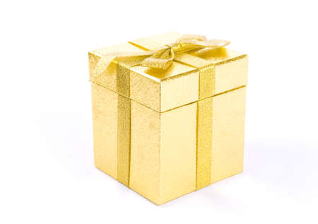 Christmas golden  giftbox on white background, with golden ribbon photo