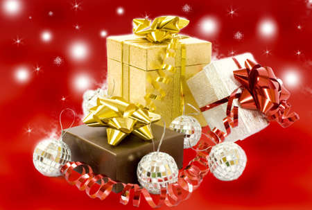Christmas gifts - three colorful gift-boxes with ribbons and decorations  photo