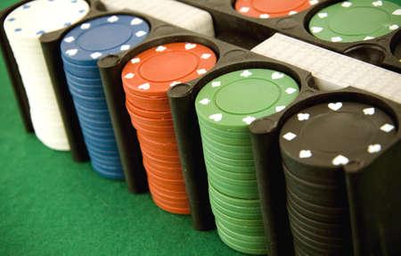 Casino gambling chips box, on green poker background photo