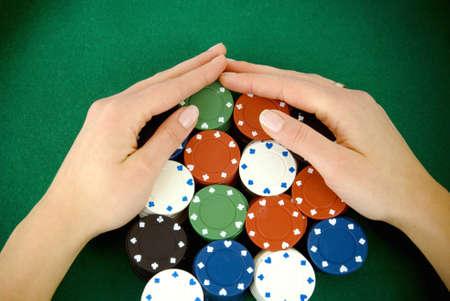 Casino win, gabmling chips taken by hands