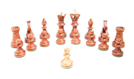 pawl: Alone against everyone, chess pawl against opposite army on white background Stock Photo