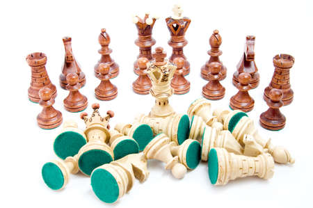 Defeat - last one standing, chess figures on white background photo