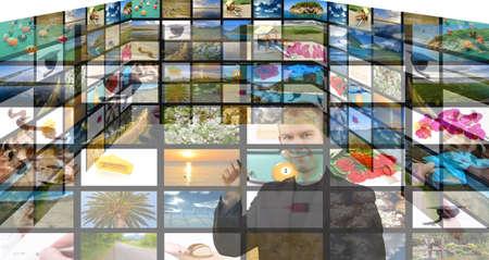 Media room, young man choosing channel on digital screen photo