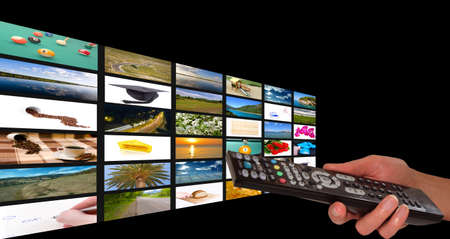 Remote in womens hand chosing channel Stock Photo