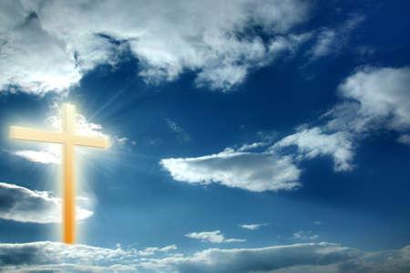 Religion cross on the blue sunny sky, heaven