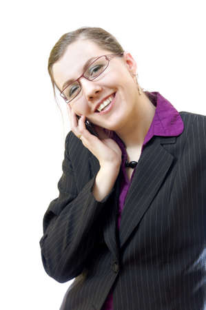 Young woman talking by cellphone, over white background photo