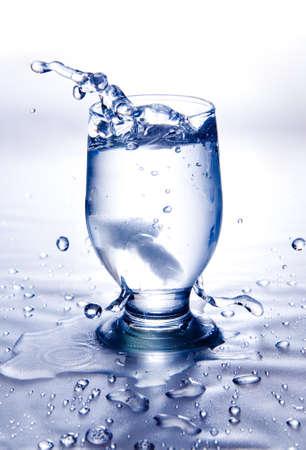Ice splash into color drink Stock Photo