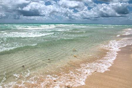 beautiful ocean beach in stromy weatcher Reklamní fotografie