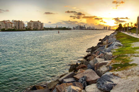 Sunset over city and ocean Stock Photo - 10087674
