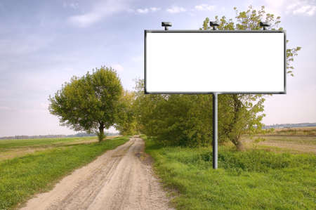 advertisment: Billboard with copyspacy near the dirty road Stock Photo