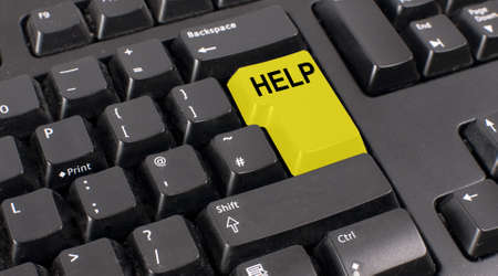 logon: Computer keyboard with yellow help button Stock Photo