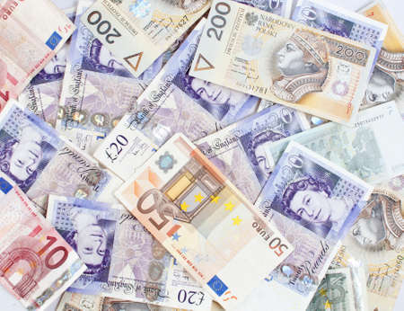 monetary concept: Background made of banknotes from different countries - monetary concept