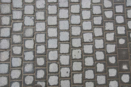 Sett pattern made of gray stones photo