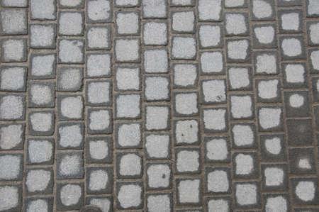 Sett pattern made of gray stones photo