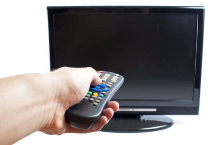 serene people: Hand swithing channel in modern television  set, on white background