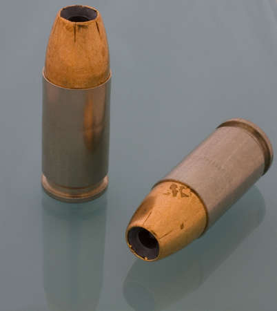 hollow pointed copper bullets for a 9 mm photo
