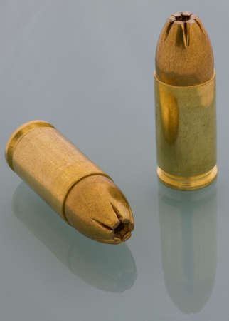 9 mm luger cartridges with hollowpoint bullets photo